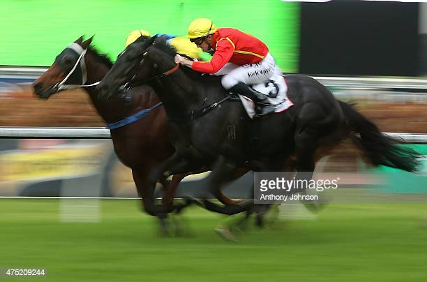 Josh Parr rides Aussies Love Sport to win race 8 The Ranvet Handicap during Sydney Racing at Rosehill Gardens on May 30 2015 in Sydney Australia