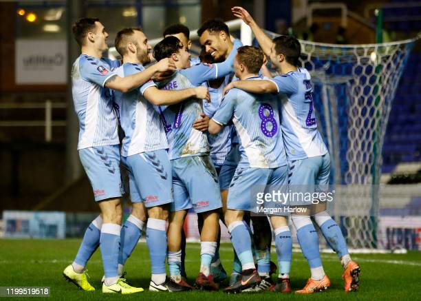 Josh Pask of Coventry City celebrates with his teammates after scoring his teams second goal during the FA Cup Third Round Replay match between...