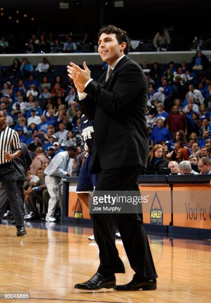 Josh Pastner, head coach of the Memphis Tigers cheers on his team against the Jackson State Tigers on November 13, 2009 at FedexForum in Memphis,...