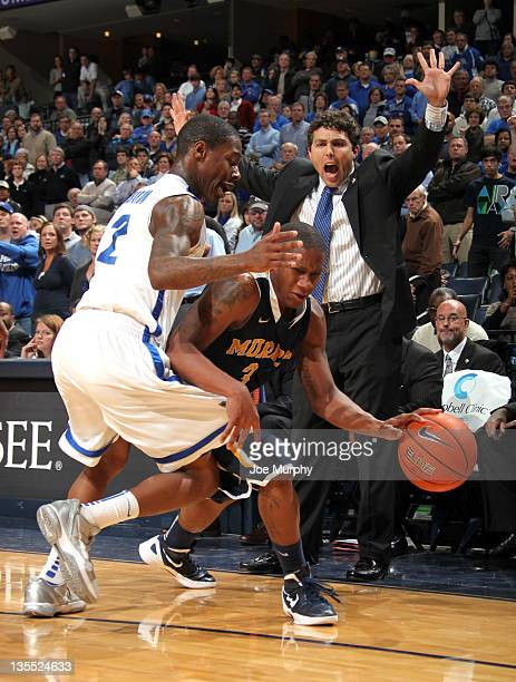 Josh Pastner head coach of the Memphis Tigers reacts as Isaiah Canaan of the Murray State Racers drives with the ball past Antonio Barton of the...