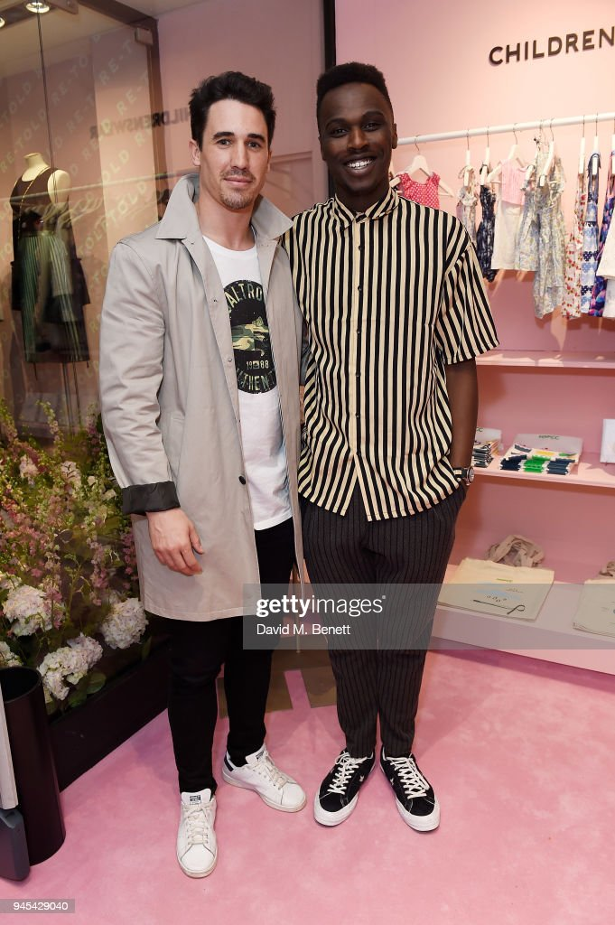 Josh Paterson and Mo Jamil (R) attend the launch of the Fashion Re-Told pop-up in aid of the NSPCC at 196 Sloane Street on April 12, 2018 in London, England. Fashion Re-Told, in association with Harrods and Cadogan, is open until May 13th, selling designer fashion items to raise funds for the NSPCC's work across the capital.