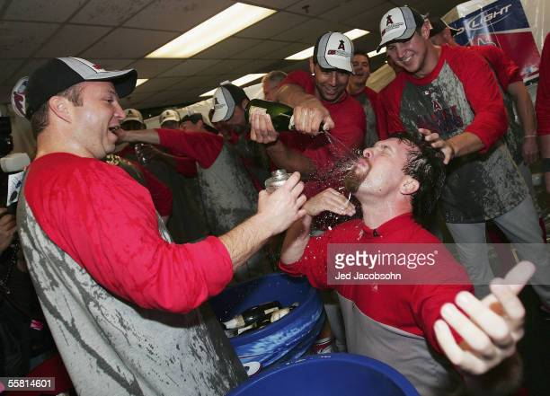 Josh Paul and Tom Taylor of the Los Angeles Angels of Anaheim celebrate after beating the Oakland Athletics and clinching the American League West...