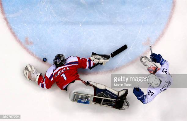 Josh Pauls of United States fails to score a goal over Martin Kudela goaltender of Czech Republic in the Ice Hockey Preliminary Round Group B game...