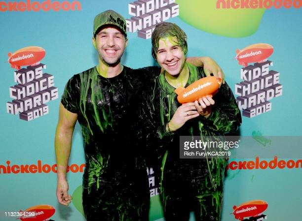 Josh Peck and David Dobrik pose with award at Nickelodeon's 2019 Kids' Choice Awards at Galen Center on March 23 2019 in Los Angeles California