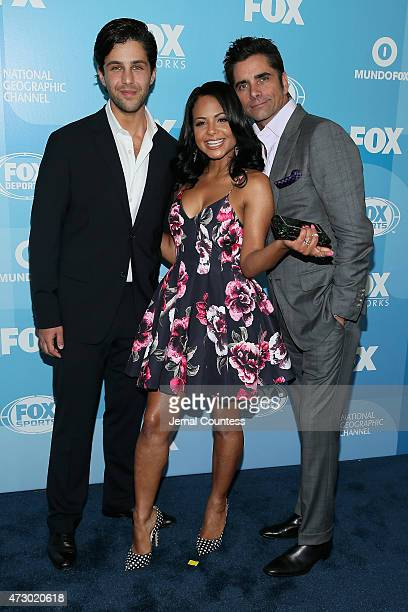 Josh Peck Christina Milian and John Stamos attend the 2015 FOX programming presentation at Wollman Rink in Central Park on May 11 2015 in New York...