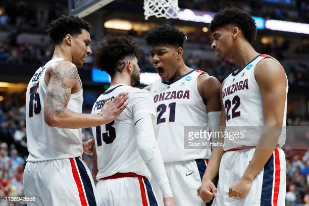 Josh Perkins of the Gonzaga Bulldogs celebrates with Brandon Clarke Rui Hachimura and Jeremy Jones after a play against the Florida State Seminoles...