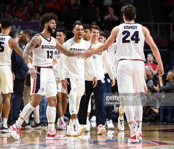 Josh Perkins of the Gonzaga Bulldogs celebrates with teammate Corey Kispert during a semifinal game of the West Coast Conference basketball...