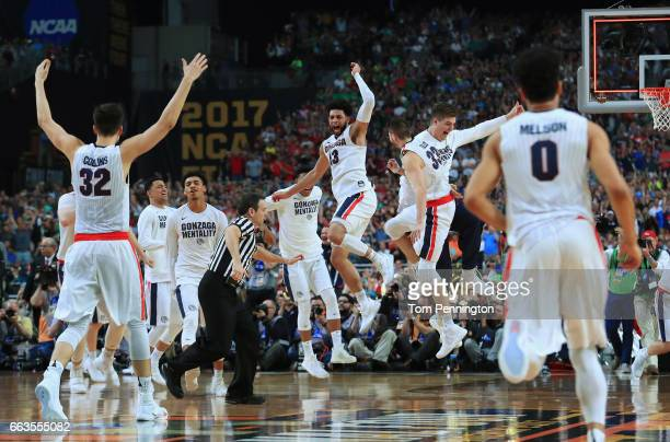 Josh Perkins of the Gonzaga Bulldogs celebrates with teammates after defeating the South Carolina Gamecocks during the 2017 NCAA Men's Final Four...