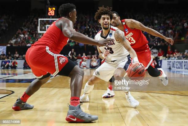 Josh Perkins of the Gonzaga Bulldogs dribbles during the second half against the Ohio State Buckeyes in the second round of the 2018 NCAA Men's...