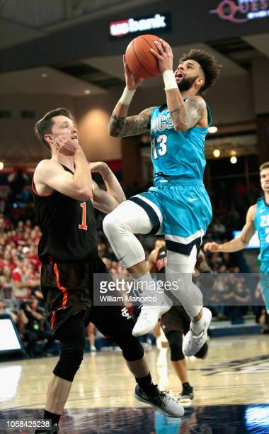Josh Perkins of the Gonzaga Bulldogs goes to the basket against Andrew Vaughn of the Idaho State Bengals in the first half at McCarthey Athletic...
