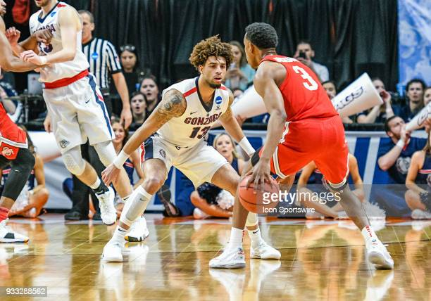 Josh Perkins of the Gonzaga Bulldogs guards G C.J. Jackson at Ohio State Buckeyes during the NCAA Division I Men's Championship Second Round...