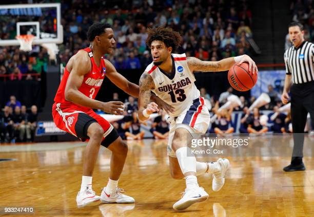 Josh Perkins of the Gonzaga Bulldogs handles the ball against CJ Jackson of the Ohio State Buckeyes during the first half in the second round of the...