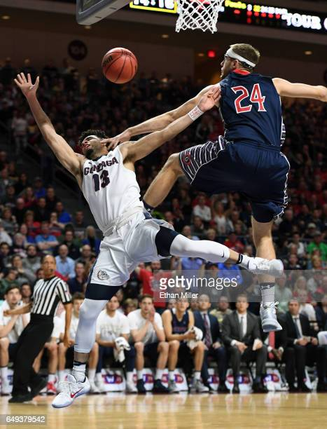 Josh Perkins of the Gonzaga Bulldogs is fouled by Calvin Hermanson of the Saint Mary's Gaels during the championship game of the West Coast...