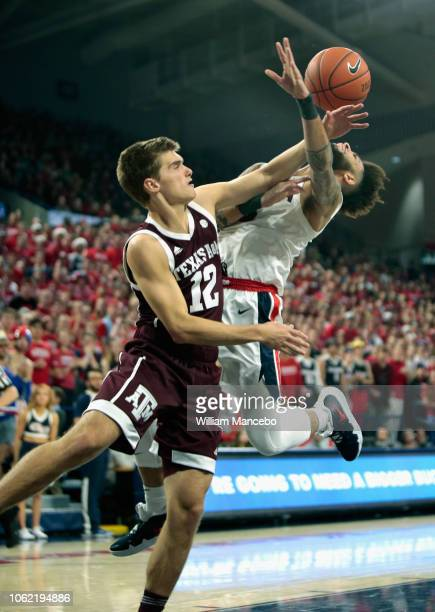 Josh Perkins of the Gonzaga Bulldogs is fouled by Chris Collins of the Texas AM Aggies in the first half at McCarthey Athletic Center on November 15...