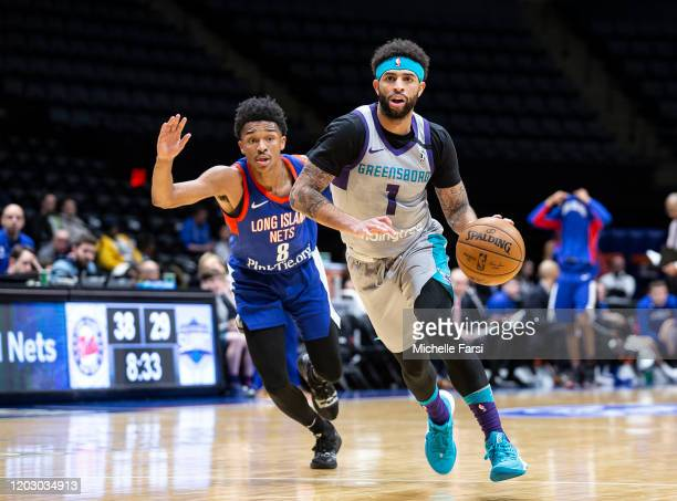 Josh Perkins of the Greensboro Swarm takes the ball against Jaylen Hands of the Long Island Nets during an NBA G-League game on February 24, 2020 at...