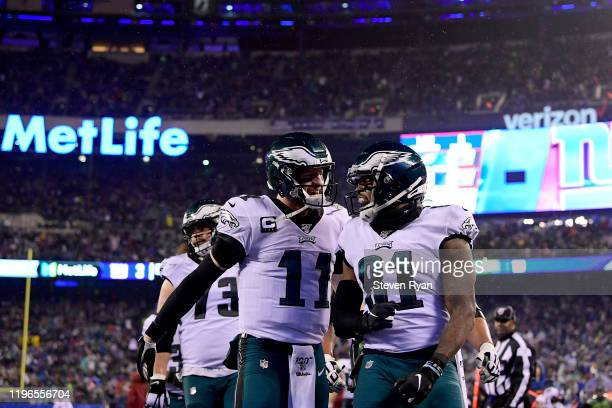 Josh Perkins of the Philadelphia Eagles celebrates with Carson Wentz after scoring a touchdown against the New York Giants during the second quarter...