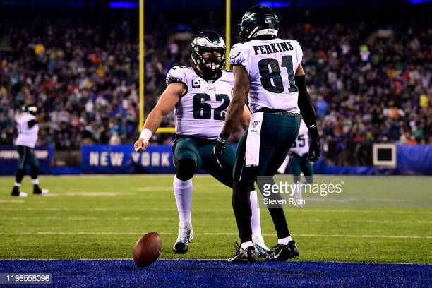 Josh Perkins of the Philadelphia Eagles celebrates with Jason Kelce after scoring a touchdown against the New York Giants during the second quarter...