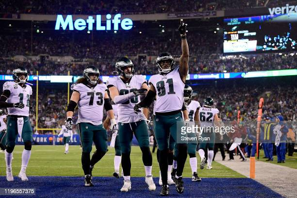 Josh Perkins of the Philadelphia Eagles celebrates with teammates after scoring a touchdown against the New York Giants during the second quarter in...