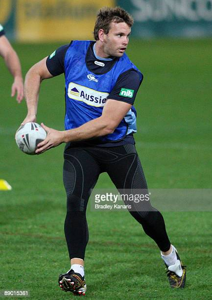 Josh Perry looks to pass during a New South Wales Blues State of Origin training session at Suncorp Stadium on July 14 2009 in Brisbane Australia