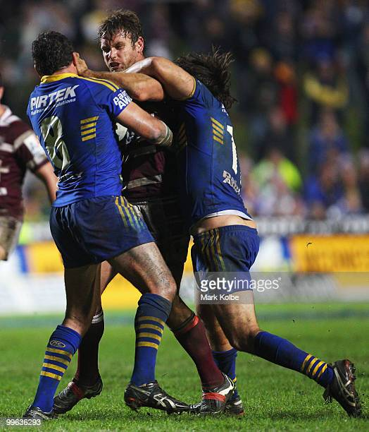 Josh Perry of the Eagles is tackled during the round ten NRL match between the Manly Sea Eagles and the Parramatta Eels at Brookvale Oval on May 17...