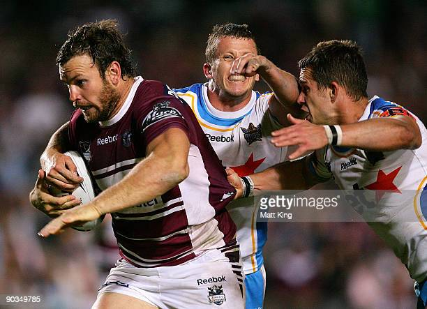 Josh Perry of the Sea Eagles busts through the defence during the round 26 NRL match between the Manly Warringah Sea Eagles and the Gold Coast Titans...
