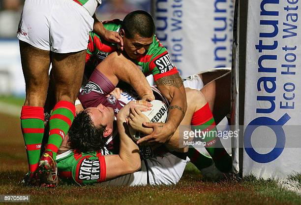 Josh Perry of the Sea Eagles is held up over the line during the round 22 NRL match between the Manly Warringah Sea Eagles and the South Sydney...