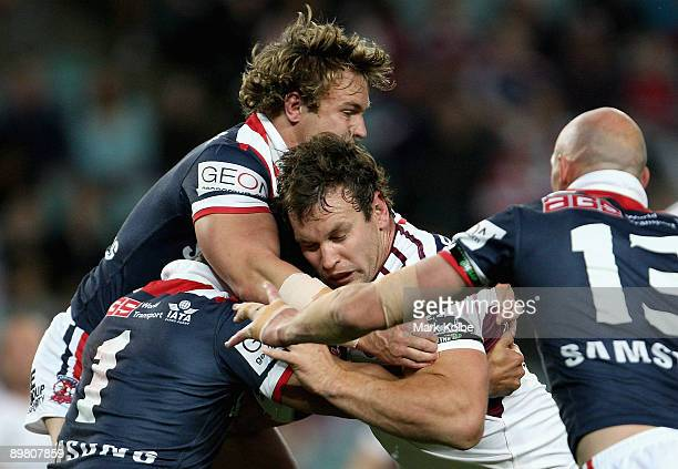 Josh Perry of the Sea Eagles is tackled during the round 23 NRL match between the Sydney Roosters and the Manly Warringah Sea Eagles at the Sydney...