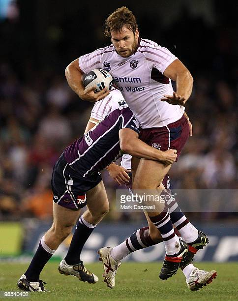 Josh Perry of the Sea Eagles is tackled during the round six NRL match between the Melbourne Storm and the Manly Sea Eagles at Etihad Stadium on...