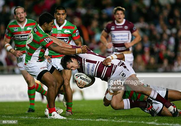 Josh Perry of the Sea Eagles takes on the defence during the round 22 NRL match between the Manly Warringah Sea Eagles and the South Sydney Rabbitohs...