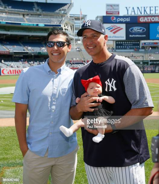 Josh Pettitte poses with his father former Yankees pitcher Andy Pettitte and 6weekold granddaughter of Andy Preslee Pettitte on Fathers day during...
