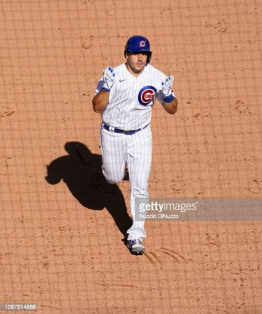 Josh Phegley of the Chicago Cubs rounds the bases following his home run during the seventh inning of Game One of a doubleheader against the St....