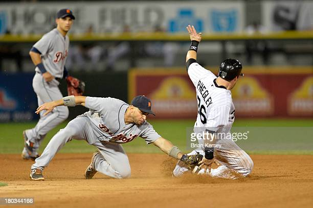 Josh Phegley of the Chicago White Sox steals second base as second baseman Omar Infante of the Detroit Tigers puts on a late tag during the fifth...