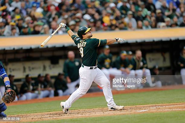 Josh Phegley of the Oakland Athletics bats during the game against the Toronto Blue Jays at Oco Coliseum on July 21 2015 in Oakland California The...