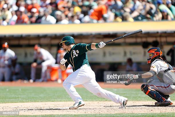 Josh Phegley of the Oakland Athletics bats during the game against the Baltimore Orioles at Oco Coliseum on August 5 2015 in Oakland California The...