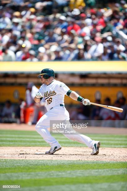 Josh Phegley of the Oakland Athletics bats during the game against the Boston Red Sox at the Oakland Alameda Coliseum on May 21 2017 in Oakland...