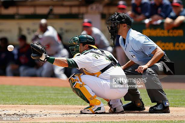 Josh Phegley of the Oakland Athletics catches in the first inning against the Minnesota Twins at Oco Coliseum on July 19 2015 in Oakland California