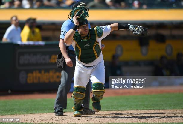 Josh Phegley of the Oakland Athletics chases after a foul popup off the bat of Carlos Correa of the Houston Astros in the top of the six inning at...