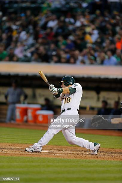 Josh Phegley of the Oakland Athletics hits a home run during the game against the Tampa Bay Rays at Oco Coliseum on August 22 2015 in Oakland...