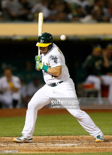 Josh Phegley of the Oakland Athletics is hit by a pitch in the bottom of the fifth inning against the New York Yankees at Ring Central Coliseum on...