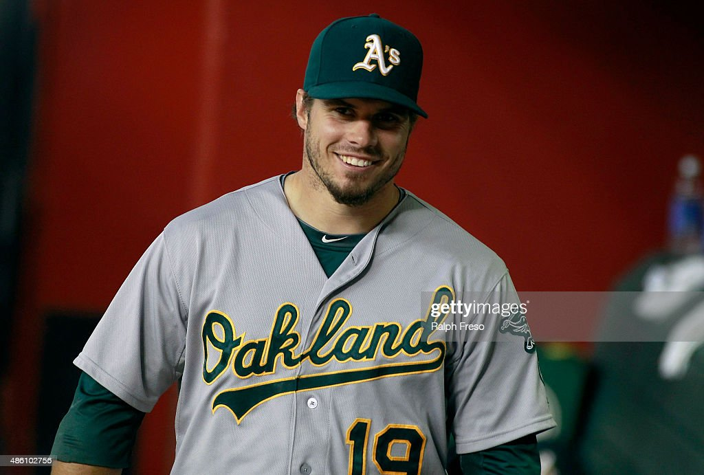 Josh Phegley #19 of the Oakland Athletics looks on from the dugout before the start of a MLB game against the Arizona Diamondbacks at Chase Field on August 28, 2015 in Phoenix, Arizona. The Diamondbacks defeated the Athletics 6-4.