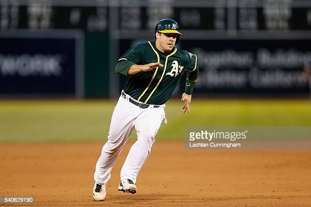 Josh Phegley of the Oakland Athletics runs to third base and on to score on a double hit by Billy Burns of the Oakland Athletics in the fourth inning...