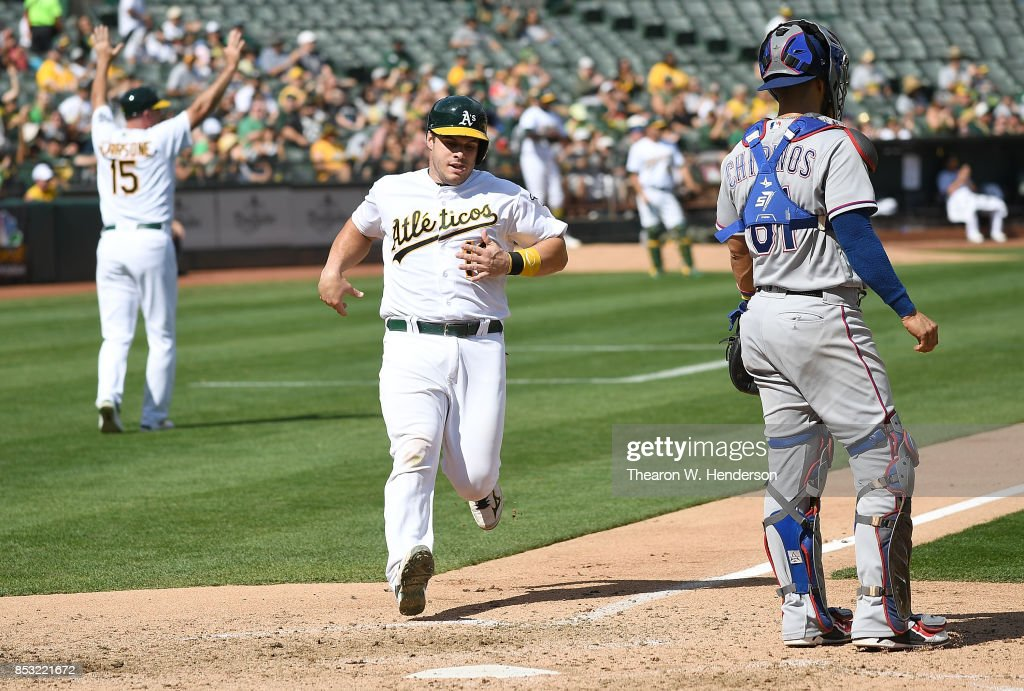 Josh Phegley #19 of the Oakland Athletics scores against the Texas Rangers in the bottom of the fifth inning at Oakland Alameda Coliseum on September 24, 2017 in Oakland, California.