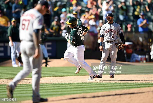Josh Phegley of the Oakland Athletics trots around the bases after hitting a tworun homer off of Vincent Velasquez of the Houston Astros in the...