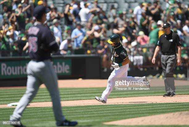 Josh Phegley of the Oakland Athletics trots around the bases after hitting a tworun home run off of Adam Plutko of the Cleveland Indians in the...