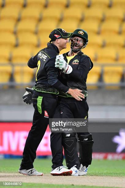 Josh Philippe of Australia and Matthew Wade of Australia celebrate during game four of the International T20 series between New Zealand Blackcaps and...