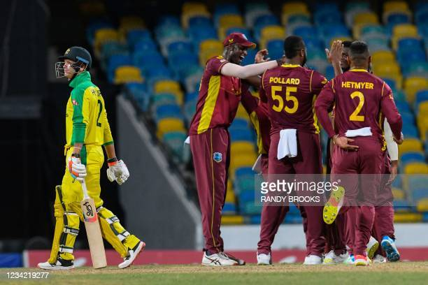 Josh Philippe of Australia walks off the field dismissed by Alzarri Joseph as Jason Holder of West Indies celebrate during the 3rd and final ODI...