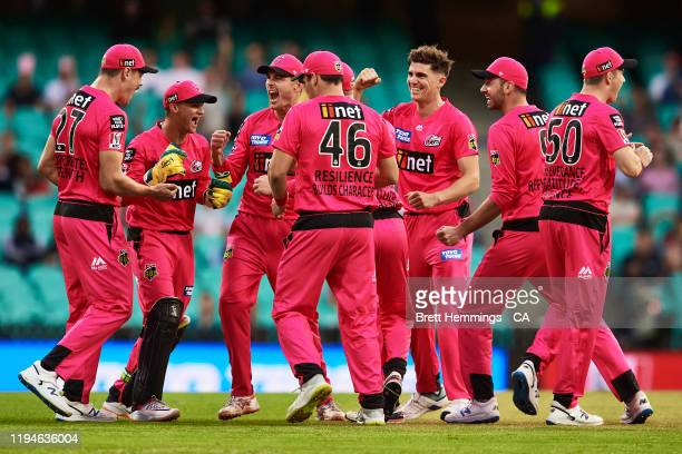 Josh Philippe of the Sixers celebrates with team mates after running out Ashton Turner of the Scorchers during the Big Bash League match between the...