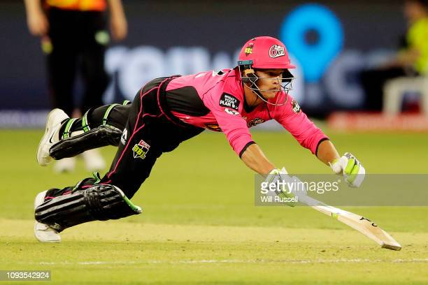Josh Philippe of the Sixers dives for the crease during the Big Bash League match between the Perth Scorchers and the Sydney Sixers at Optus Stadium...