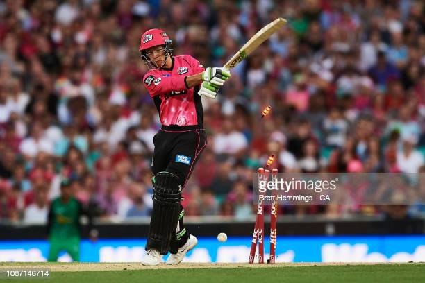 Josh Philippe of the Sixers is bowled out by DJ Bravo of the Stars during the Big Bash League match between the Sydney Sixers and the Melbourne Stars...