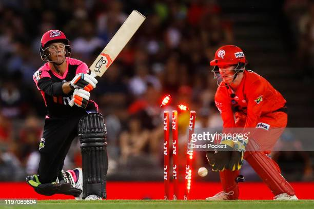 Josh Philippe of the Sixers is clean bowled by Tom Andrews of the Renegades during the Big Bash League match between the Melbourne Renegades and the...